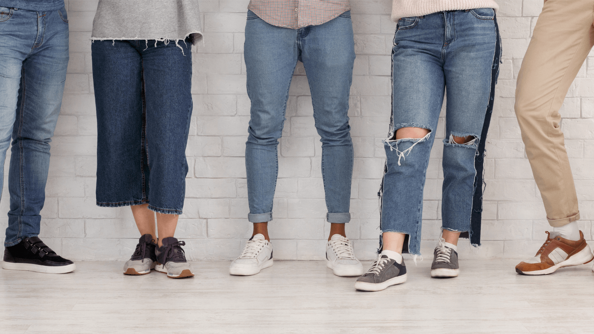 Legs of Friends Showing Different Jean Types